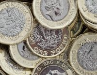 A pile of GBP pound coins.